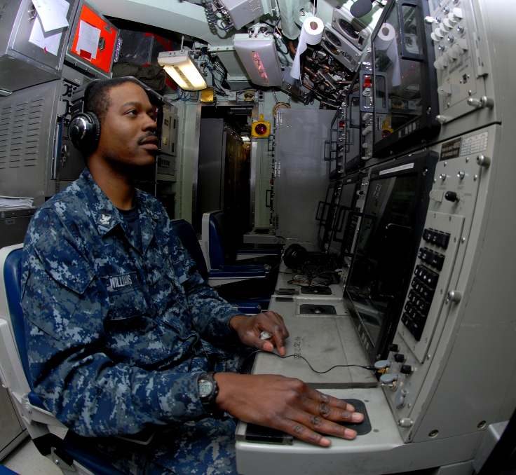 Sonar operator aboard a Los Angeles class attack submarine