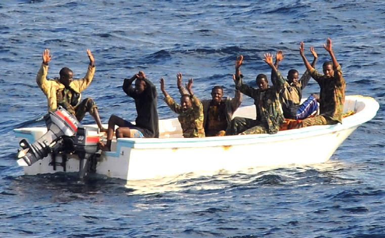 Pirates surrender, throwing weapons overboard - thanks for your cooperation