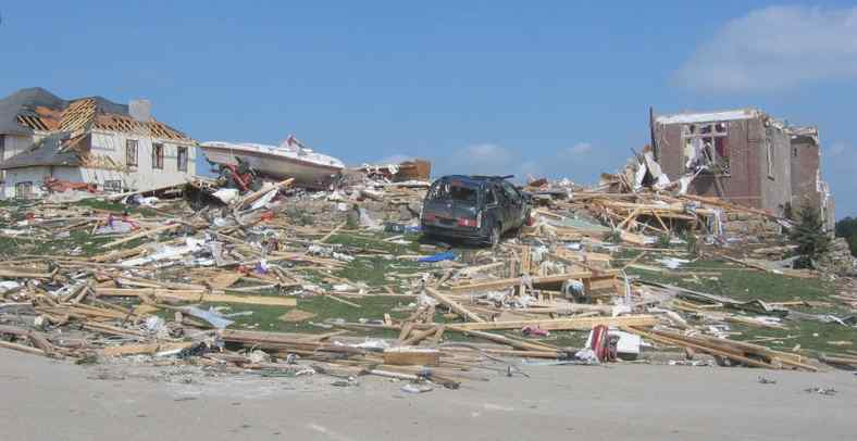 Tornado EF3 damage - roof and some inner walls of brick building have been demolished