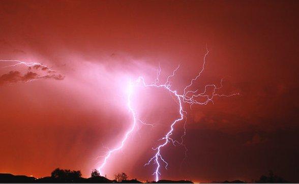 Red Lightning Storm Lightning illuminates the