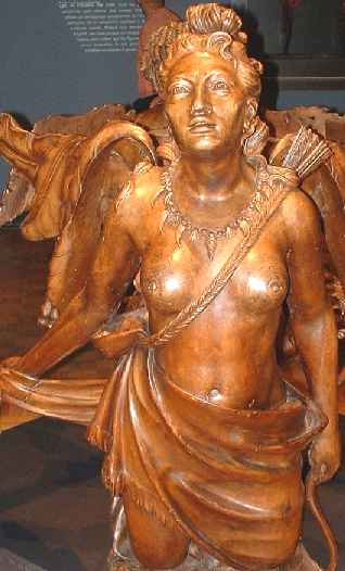 An outstanding carving of the female form in teak