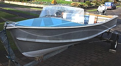 Blue decked Pearly Miss sports boat