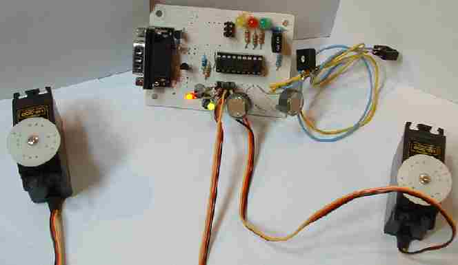 Test rig of comparator photoresistor circuit powering two servos