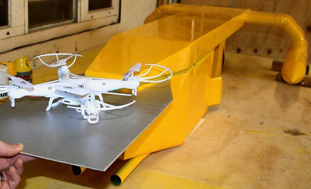 Robot ship with a quadcopter on a rear mounted landing pad