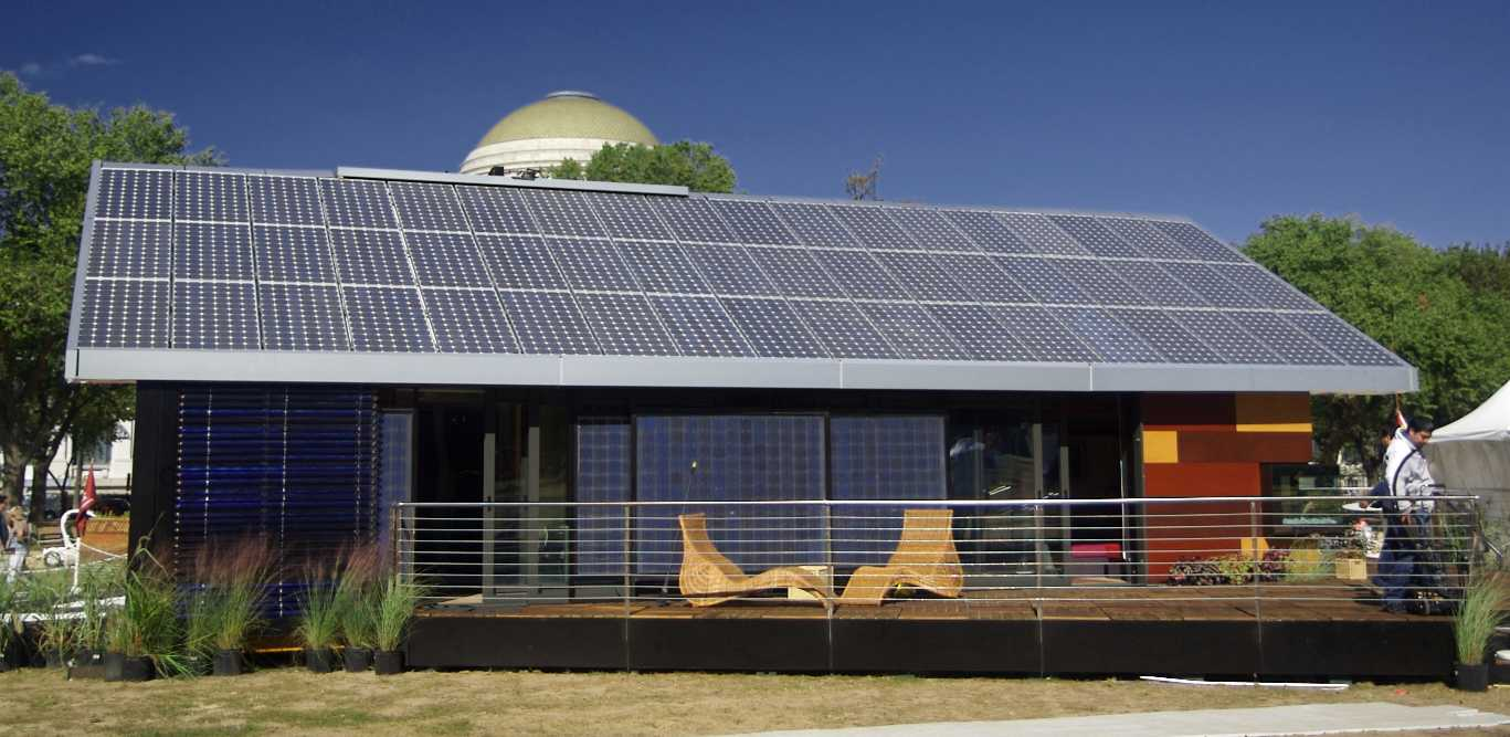 Eco home with solar panels and passive glazing